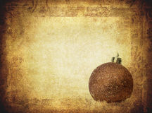 Bauble over vintage paper Royalty Free Stock Photo
