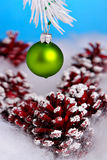 Bauble and pine cones. Hanging bauble and pine cones in snow Stock Photography