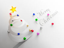 Bauble Sliding Down From a Paper Christmas Tree Stock Photography