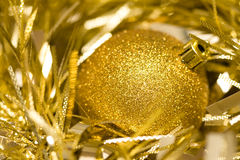 Bauble and tinsel. A close up of a christmas bauble nestled among some tinsel Royalty Free Stock Photos