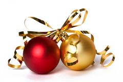 Baubles 1. Two cristmass baubles with gold ribbon bow stock image