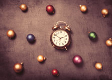 Baubles and alarm clock Royalty Free Stock Photos