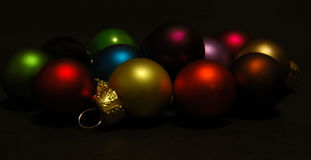Baubles on black background Stock Photography