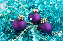 Baubles and blue tinsel Stock Images