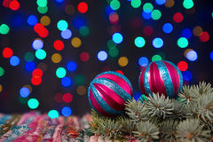 Baubles on Christmas lights background. Colorful baubles, spruce and Christmas lights background Royalty Free Stock Photos
