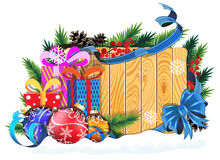 Baubles and Christmas presents on wooden background Stock Photography