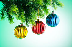 Baubles on christmas tree Stock Images