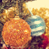Baubles on a christmas tree, with a filter effect Royalty Free Stock Images