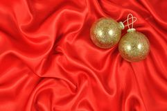 Baubles on Crimson Satin Stock Photos