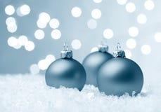 Baubles do Natal no gelo Fotos de Stock Royalty Free