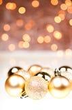 Baubles dourados do Natal Fotos de Stock Royalty Free