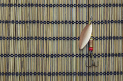 Baubles for fishing. On the background of bamboo napkins Stock Photos