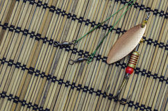 Baubles for fishing. On the background of bamboo napkins Stock Image