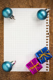 Baubles and gifts with empty paper sheet Royalty Free Stock Image