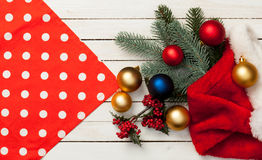 Baubles and gifts with Santa Claus hat Royalty Free Stock Images
