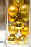 Baubles in a Glass. Christmas baubles thrown into a tall clear crystal vase Stock Images