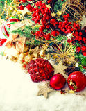 Baubles, golden garlands, christmas tree and red berries Royalty Free Stock Photos