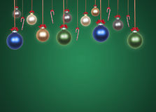 Baubles on green background Stock Photography