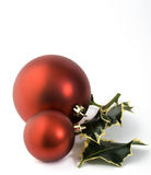 Baubles and holly Stock Photography