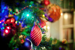 Baubles and lights on Christmas tree Stock Photo