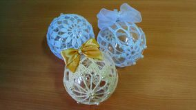 Baubles made on crochet. Three baubles made on crochet. Two white, one beige Royalty Free Stock Photography