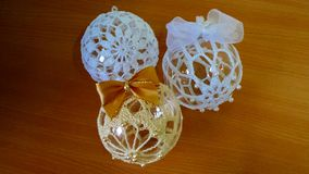 Baubles made on crochet. Three baubles made on crochet. Two white, one beige Royalty Free Stock Image