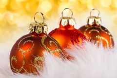 Baubles over abstract lights background Royalty Free Stock Image