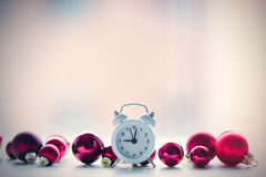 Baubles and retro alarm clock Stock Photography