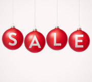 Baubles with sale label Royalty Free Stock Images