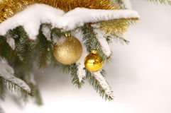 Baubles on snow Stock Photography