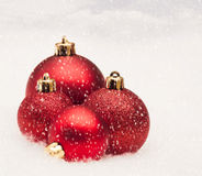 Baubles in Snow Stock Images