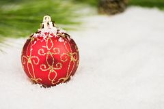 Baubles in the snow. Royalty Free Stock Images