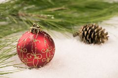 Baubles in the snow. Stock Image
