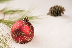 Baubles in the snow. Royalty Free Stock Photo