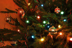 Baubles and sparkiling lights on a Christmas tree. Royalty Free Stock Image