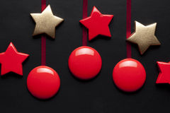 Baubles and stars. On black background Royalty Free Stock Images