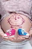 Bauch mit Zeichnung Stockfotos