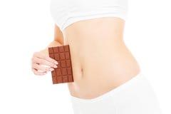 Bauch und Schokolade Stockfoto
