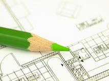 Bauen Sie ein Haus und Architektenhilfsmittel auf Stockbild
