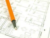 Bauen Sie ein Haus und Architektenhilfsmittel auf Stockfotografie