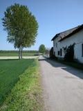 Bauernhof und Straße Stockbilder