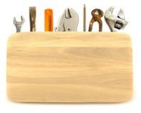 Bauhintergrund Werkzeuge unter die hölzerne Planke Stockbilder