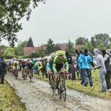 Велосипедист Bauke Mollema на мощенной булыжником дороге - Тур-де-Франс 201 Стоковое фото RF