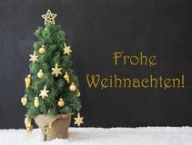 Baum, Frohe Weihnachten bedeutet frohe Weihnachten, Schwarz-Beton Lizenzfreie Stockfotos