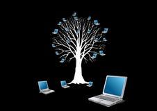 Baum und Laptope Stockfoto