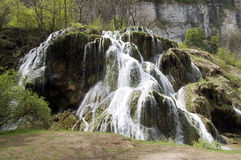 Baumes Les Messieurs waterfall in Jura, France. View of Baumes Les Messieurs waterfall in Jura, France royalty free stock photos