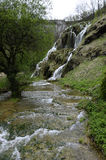Baumes Les Messieurs waterfall in Jura, France. View of Baumes Les Messieurs waterfall in Jura, France royalty free stock photo