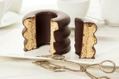 Baumkuchen, German layer cake on coffee table Stock Image
