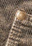 Baumwollsamtbeschaffenheit mit Knopf stockfoto