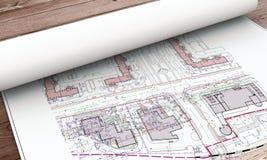 Bauplanrollen auf dem Tisch Stockfotografie